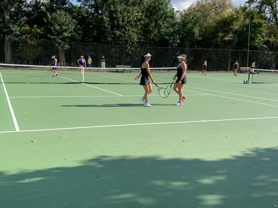 The Allderdice Tennis team hard at work during practice.