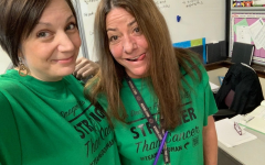 Ms. Goodman and Ms. Britton pose in their shirts.