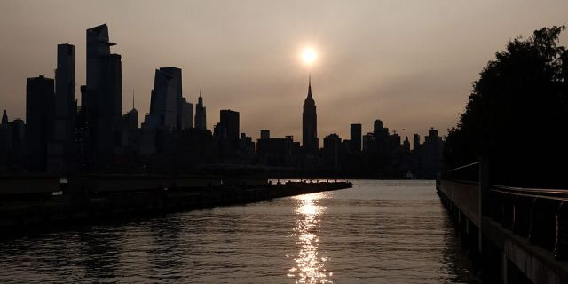 """West Coast Wildfire smoke blows eastward covering a New York sunrise."" - Courtesy of Fox News"