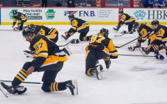 The Penguins players celebrate captain Sidney Crosby's 1,000th NHL game  by all wearing #87 jerseys and mimicking his skate tying routine.