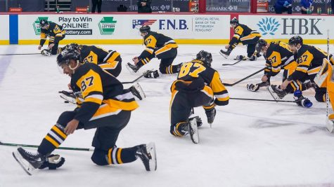 The Penguins players celebrate captain Sidney Crosbys 1,000th NHL game  by all wearing #87 jerseys and mimicking his skate tying routine.