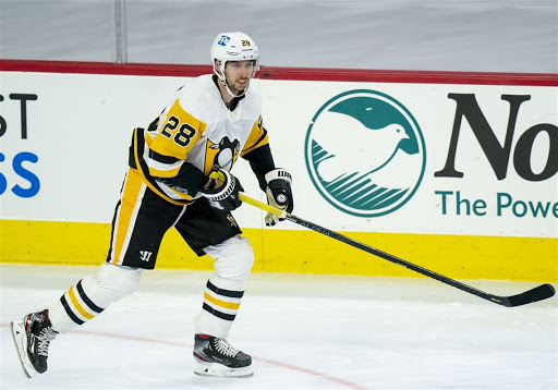 Penguins defenseman Marcus Pattersson looks up the ice during a game against the Flyers.