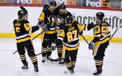 From left to right: John Marino, Mike Matheson, Bryan Rust, Sidney Crosby, and Jake Guentzel celebrate a goal