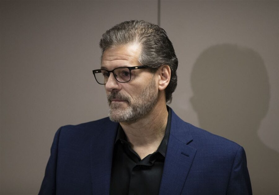 Ron Hextall speaks to the media in 2018.